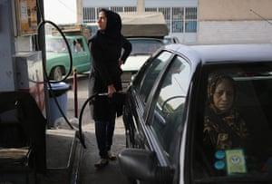 Agencies Iran Moore: a woman fills her gas tank