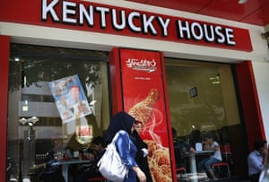 Agencies Iran Moore: women pass a fried chicken fast food restaurant in Isfahan