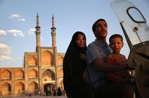 Agencies Iran Moore:  family on bike Amir Chakhmaq Hosseinieh worship site