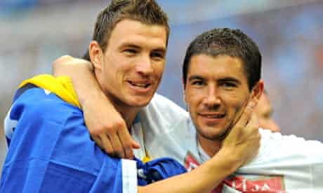 Edin Dzeko, left, with Manchester City's Serbian defender Aleksandar Kolarov celebrate after FA Cup