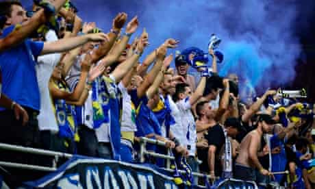 Bosnia-Herzegovina fans cheer on their team as they played Ivory Coast in St Louis, Missouri, last w
