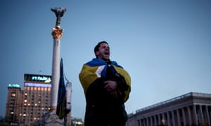 An anti-government protester shout slogans at Kiev's Maidan square on 4 February, 2014.