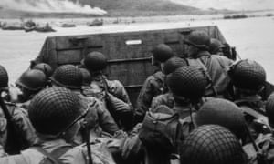 A platoon of soldiers in a landing vehicle during D-day.