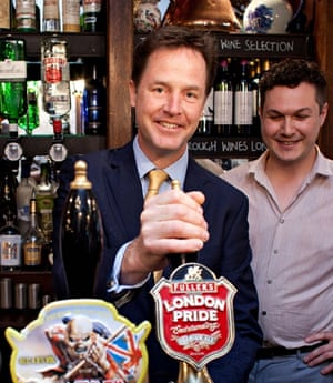 Nick Clegg pulls a pint at the Queens Head in Soho. Photograph: Ben Gurr/Getty Images