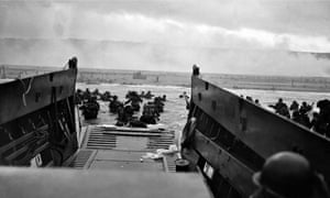 US troops wading from landing craft towa