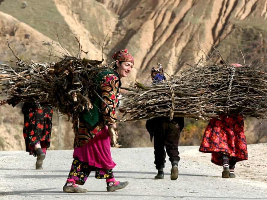 Tajik women carry brushwood near the village of Zidekh, 72 km (45 miles) north of the capital Dushanbe, in 2001.