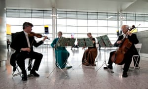 Musicians inside the redeveloped T2 building at Heathrow on 4 June 2014