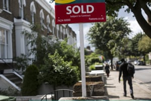 An estate agent sold sign is displayed outside a property on June 3, 2014 in London, England.