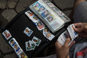 A vendor sells stickers of the FIFA World Cup album, on the streets of Rio de Janeiro, Brazil, on May 29, 2014.