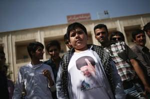 Agencies Iran Moore: boy Iran Ayatollah T-shirt.