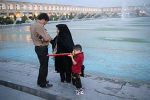 Agencies Iran Moore: family by fountain