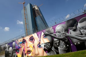 Graffiti covers a fence around the construction site of the new headquarters of the European Central Bank on August 30, 2013 in Frankfurt, Germany.