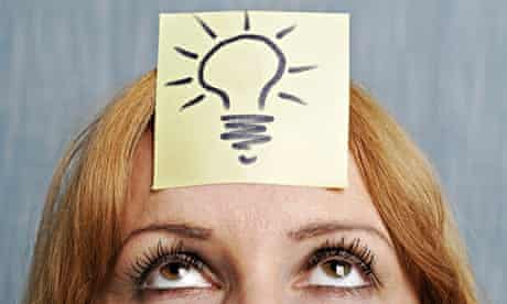 Woman with lightbulb on her head