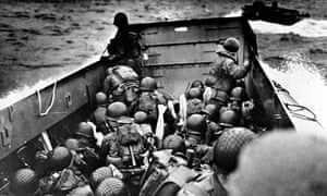D-day: Allied troops crouch behind the bulwarks of a landing craft as it nears Omaha Beach on D-day