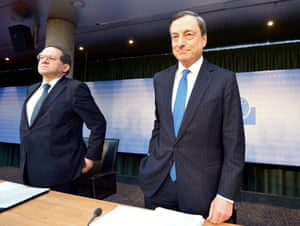 Mario Draghi (R), president of the European Central Bank (ECB) and his Vice-President Vitor Constancio (L) arrive at the ECB's June press conference