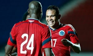 Colombia's Carlos Bacca celebrates his goal against Senegal with his team-mate Victor Ibarbo.