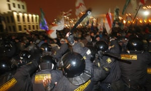 Riot police clash with anti-government demonstrators trying to storm the government building in the Belarusian capital, Minsk, on 19 December 2010, following the disputed election.