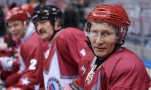 Russian President Vladimir Putin (R) and Belarusian President Alexander Lukashenko (C) attend an ice hockey match at the ice hockey palace in Sochi, Russia, this year.