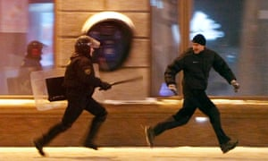 A riot policeman chases an opposition protester during a rally denouncing the results of the 2010 election in Minsk December.