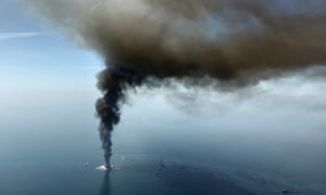 Aerial April 2010 photo shows an oil slick as BP's Deepwater Horizon oil rig burns. oil spill gulf of mexico