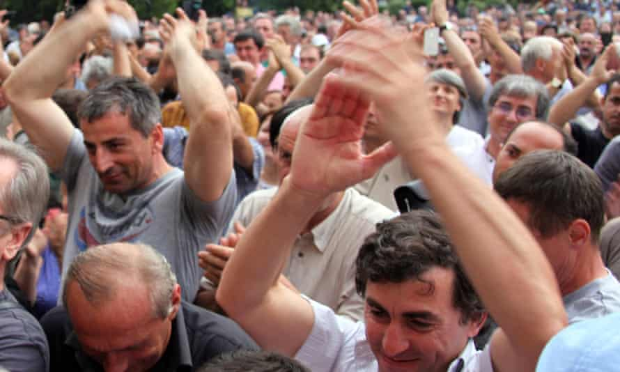 Abkhazian people applaud during a rally in Sukhumi, the capital of the Georgian breakaway republic on 31 May, 2014.