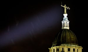 The sword and scales of justice statue atop London's central criminal court