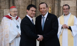 French prime minister Manuel Valls shakes hands with Tony Abbott