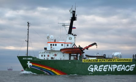 Greenpeace Arctic Sunrise approaches the  Prirazlomnaya oil rig during Save the Arctic campaign. The banner says