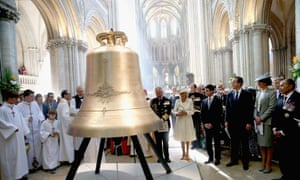 The Prince of Wales, Duchess of Cornwall, French Prime Minister Manuel Valls, Prime Minister David  Cameron and his wife Samantha, and the New Zealand General Governor Jerry Mateparae look on as a new bell is inaugurated at Bayeux Cathedral.