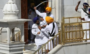 Sikh men clash at the commemorations of Operation Blue Star at the Golden Temple in Amritsar, India