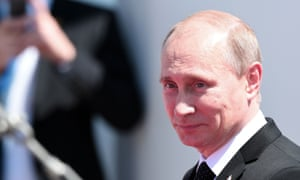 Russia's President Vladimir Putin arrives at the ceremony on the beach of Ouistreham.
