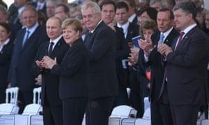 From left to right: Russian president Vladimir Putin German chancellor Angel Merkel, Czech president Milos Zeman, Australian prime minister Tony Abbott and Ukrainian president Petro Poroshenko at the international ceremony at Sword Beach.