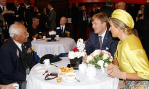 King Willem-Alexander, 2nd right, and Queen Maxima of the Netherlands speak with veteran Eduard Jacob of Arnhem, in Arromanches.