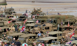 Second world war military vehicles and enthusiasts muster on Gold Beach at Arromanches to commemorate the 70th anniversary of the D-day landings.