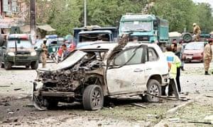 The bomb-damaged car that was carrying presidential frontrunner Abdullah Abdullah