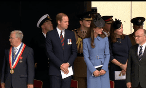 The Duke and Duchess of Cambridge watch the veterans' parade.