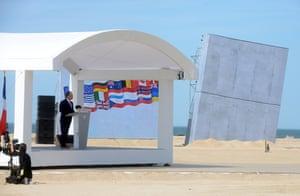 French president Francois Hollande speaks at Sword beach.