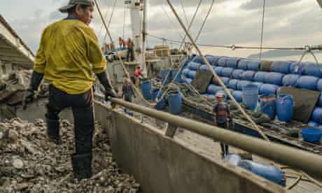 'Trash fish' used in the fishmeal fed to prawns is unloaded at a Thai dock