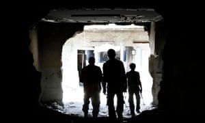Free Syrian Army fighters walk in Aleppo