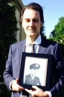 Michael Pirrie with a picture of his uncle Richard Pirrie