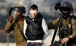 Israeli soldiers arrest Palestinian protest against Jewish settlement