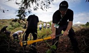 Police officers dig on scrubland in Praia da Luz