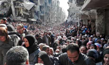 syria-residents-queue-to-receive-food-and-medical-aid