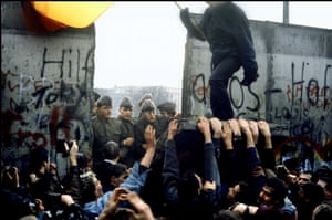 On November 9, 1989, protestors pull down the Berlin Wall.