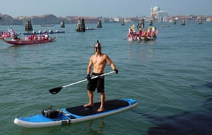 A rower takes part in the Vogalonga, or Long Row, on the Venice lagoon.