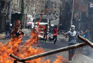 Kurdish protestors clash with riot police at a burning barricade in Diyarbakir, eastern Turkey, after a man was killed during clashes with Turkish soldiers on 7 June.