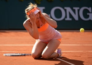 Maria Sharapova of Russia celebrates her victory over Simona Halep of Romania in the women's final of the French Open tennis tournament at Roland Garros in Paris.