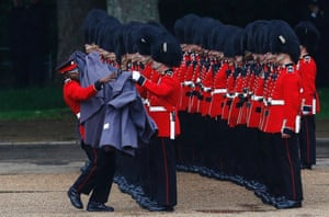 Guardsmen of the Grenadier Guards remove their capes during the Colonel's Review ceremony at Horse Guards Parade in London.