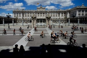 Demonstrators ride their bikes during a Naked Cycle demonstration in Madrid, Spain to protest about the  lack of cycling lanes.