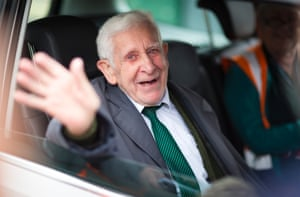 Bernard Jordan, the 90-year-old war veteran found in Normandy after being reported missing from his care home in Hove, Sussex, waves as he returns to Portsmouth on a Brittany Ferry.